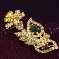Ruby Emerald White Imitation AD Stones Stylish Design Fashion Jewellery Saree Pins Collection Online  Length of the design is 32 mm and width is 15 mm Open safety pin with lock is attached in the backside of the design  Base metal is brass and copper mix alloy and plating colour is light gold tone.  Stones used are semi precious To be maintained inside a plastic cover or box while unused. Chemicals and perfumes to be avoided. Photograph shown is magnified one. Please check the dimensions above for exact siz